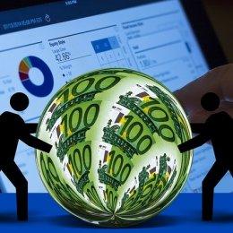 Bild mit Geld und Analysedaten zur Berechnung des Unternehmenswert